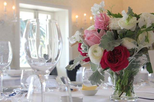 Alison and Nik at Dunbar House. Deep reds, pale pinks, white and silver, in mismatched crystal. David Austin roses, ranunculus, hyacinth and sweet pea. Stunning. Flowers by Petal & Sprout.