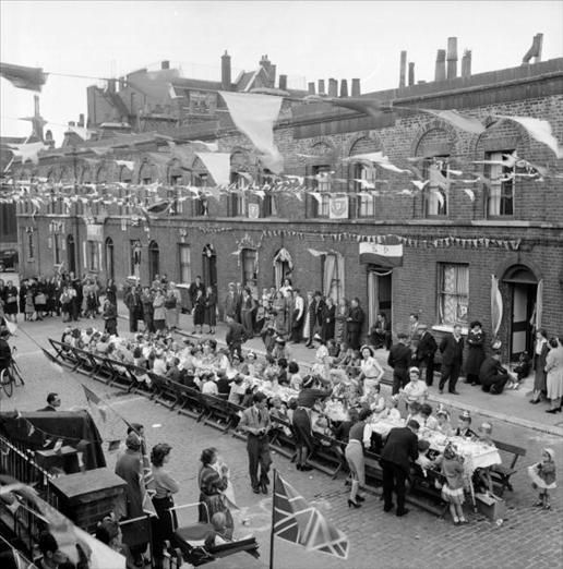 A street party at Morpeth Street, in London's East End, to celebrate the coronation of Queen Elizabeth II. Original Publication: Picture Post - 6542 - Cockneys' Own Party - pub. 1953