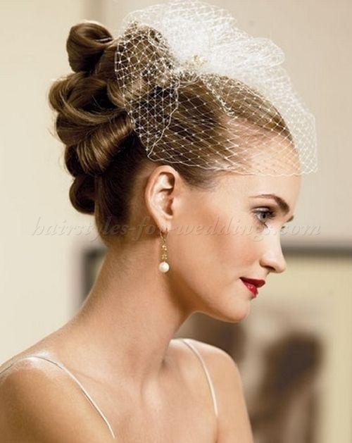 high+bun+wedding+hairstyles,+top+bun+hairstyles+for+brides+-+high+bun+hairstyle+with+birdcage+veil