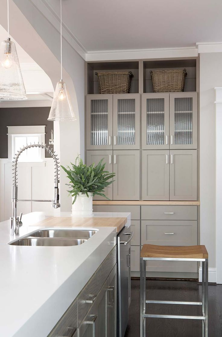 Kitchen With Thick Corian Counters And Light Lime Washed