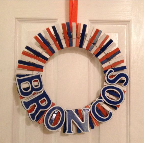 Send the Broncos to the Super Bowl! Denver Broncos Football Wreath made out of painted clothespins. Such a cute way to show your team spirit.