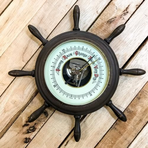 Beautifully made nautical style weather barometer, made from wood and brass and most probably made in Germany.  Would suit your eclectic home or sea vessel.