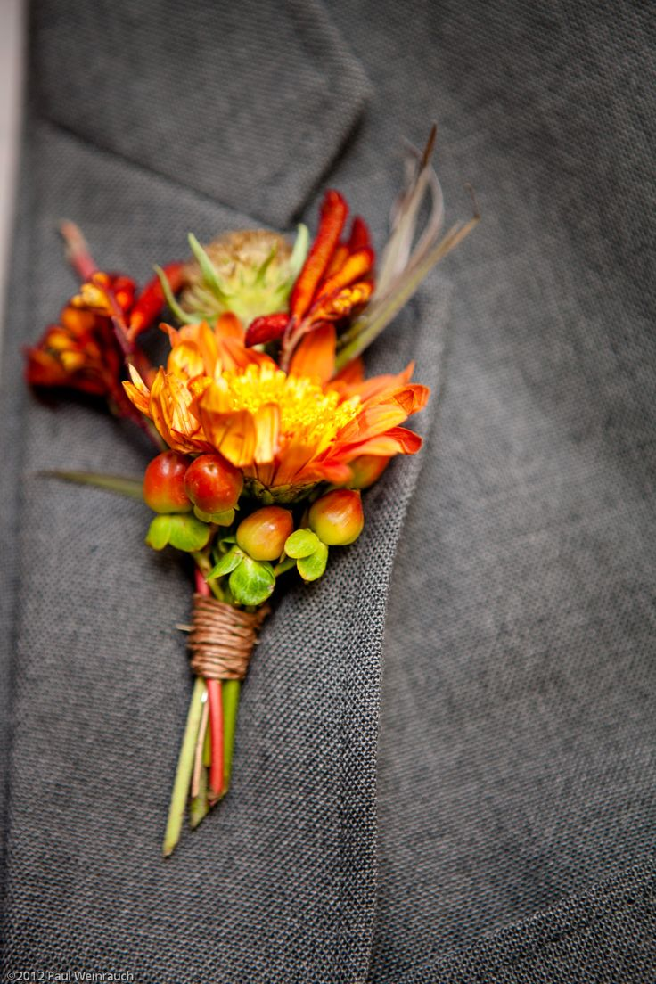 Orange wedding boutonnier with a twine wrap. I like the twine. Easy, inexpensive, and has a great country feel.