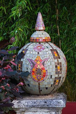 mosaic sphere with turkish tulip motif. Bowling ball, with glasses mounted to it covered in mosaics.