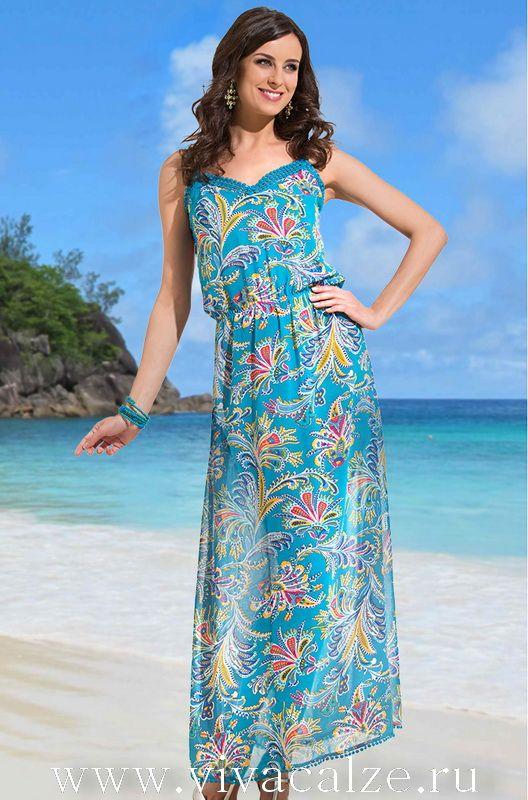 9445 пляжное платье Коллекция MAYORKA.  Длинный сарафан на тонких бретелях, полуприлегающего силуэта, выполнен из принтованного полупрозрачного шифона. Вырез и низ декорированы тесьмой.