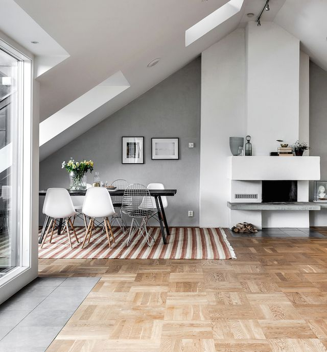 This attic apartment in Stockholm, Sweden is just stunning .. with beautiful parquetry floors and a clever open-plan design, maximising every available inch .. love the sweet little outdoor area. It h