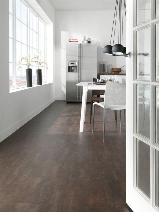 Marmoleum floor--dark color, off-set tiles, easy upkeep, green.