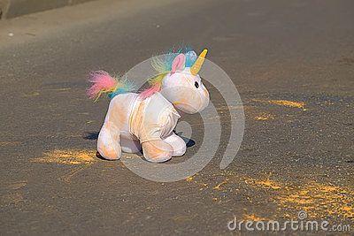 Unicorn toy on the asphalt.