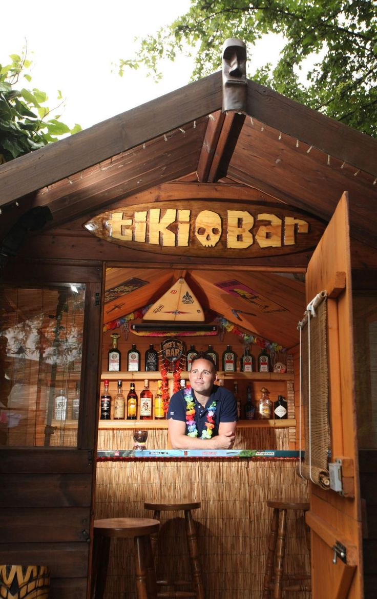 Stephen enjoys a cocktail in his Hawaiian themed Tiki Bar in Wakefield, West Yorkshire, which houses an collection of surfing memorabilia