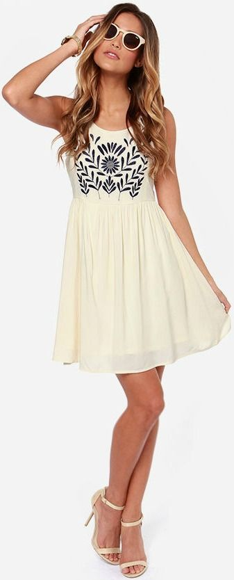 Love the detailing on the torso of the dress along with the simple pair of white ankle strap heels.