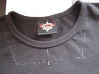 This is a no-sew project for changing a crew-neck t-shirt to a square neck.  I would sew a new binding if I were to make this shirt reconstruction.