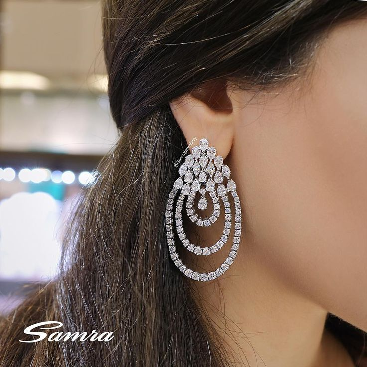 A statement earring with Pear & Brilliant cut Diamonds. #SamraJewellery#SamraHighJewellery