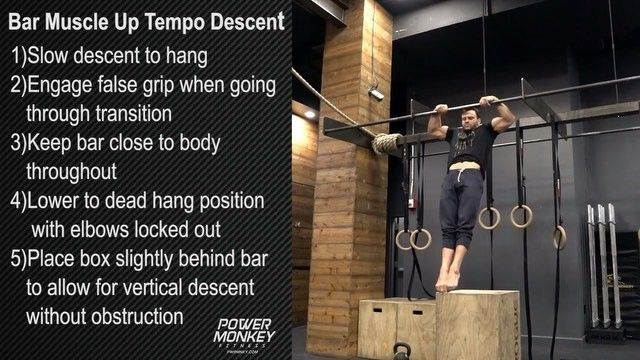 Bar Muscle Up Tempo Descent  1)Slow descent to hang 2)Engage false grip when going through transition 3)Keep bar close to body throughout 4)Lower to dead hang position with elbows locked out 5)Place box slightly behind bar to allow for vertical descent without obstruction  PWRMNKY.com #monkeymethod #techniquematters #crossfit #gymnastics #powermonkey @davedurante