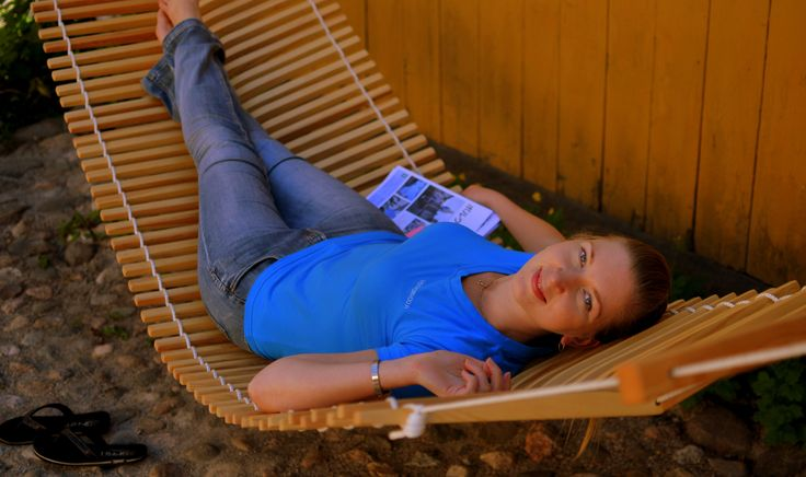 Travel officer Anna trying a wooden hammock. Want to buy one? This customised hammock is so comfy that you will fall asleep! Designer Päivi Mikola recommends you to order one in andvance. www.visitporvoo.fi