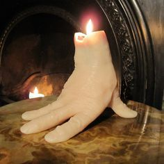 Hand-shaped Candle For Halloween. make your own version with a surgical glove. make your halloween party spooktacular http://halloween-party.fastblogger.uk/