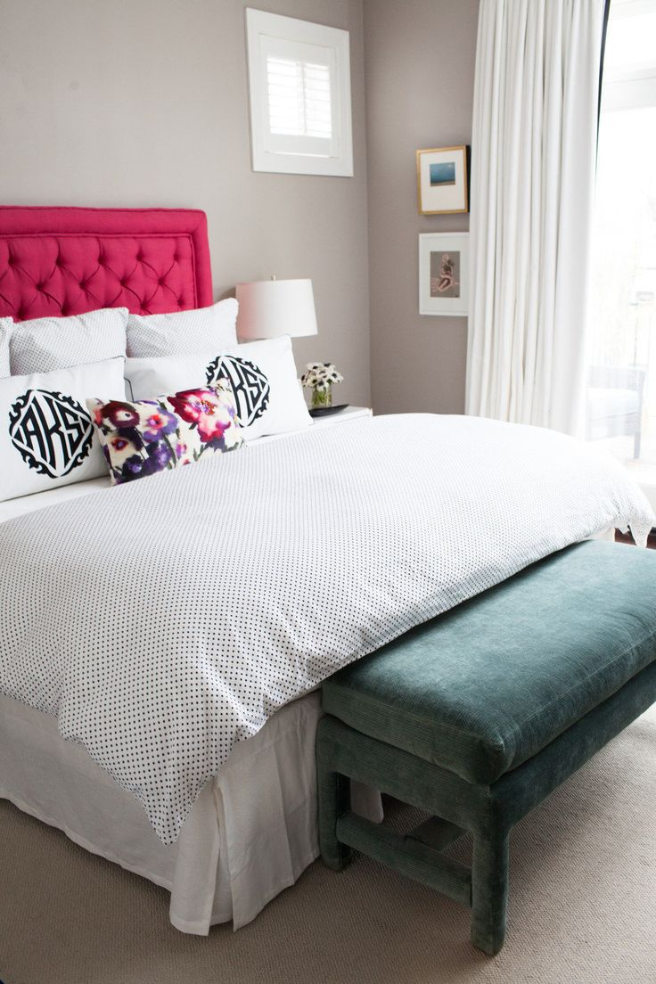 Pink headboard with black and white polka dot bedding