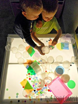 Exploring with loose parts on the light table from And Next Comes L