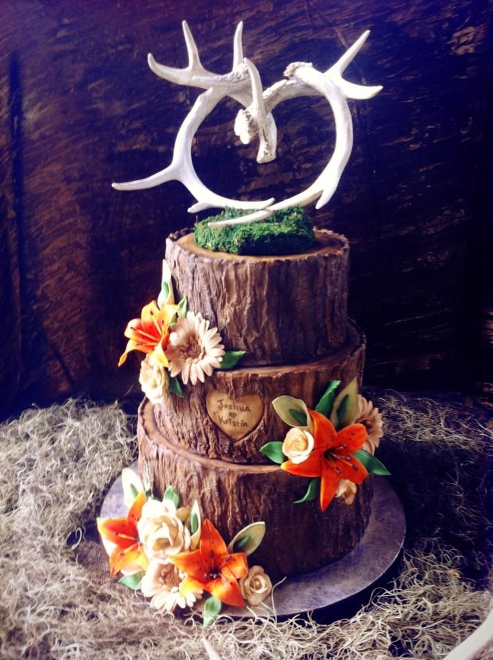I love this cake. it would be the perfect country wedding cake! different color flowers though.