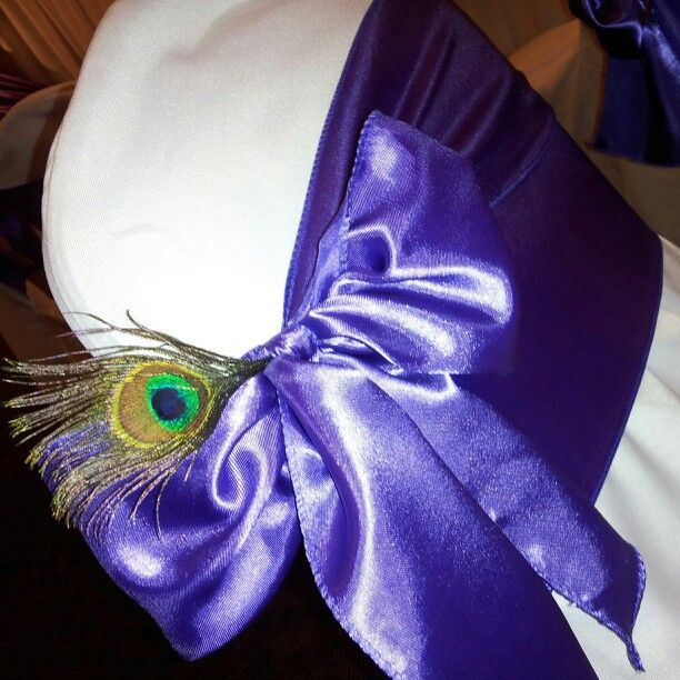 Spruce up your chair covers and sashes with a little embellishment--peacock feather