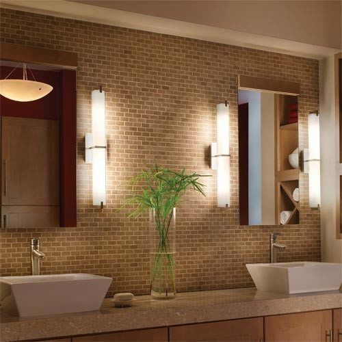 How to Light a Bathroom.  Tips: overhead not flattering; light in shower.....   Metro Vanity Light from TECH Lighting