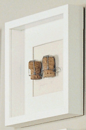 Deep-set, box-mount frames are a fantastic way to display memorable pieces, (in this example - a champagne cork) from a special celebration, bits and pieces from your travels, a collection of some sort, or your prized signed ticket stub.