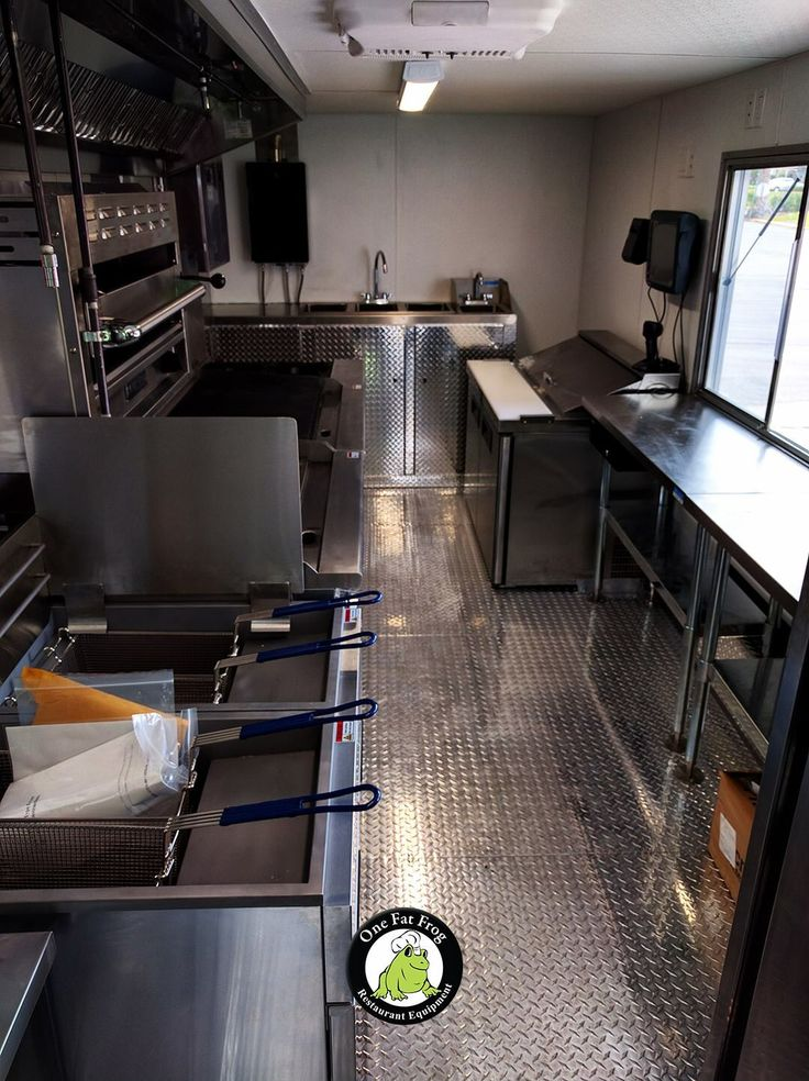 Interior of a fully equipped workhorse mobile kitchen food trailer at One Fat Frog