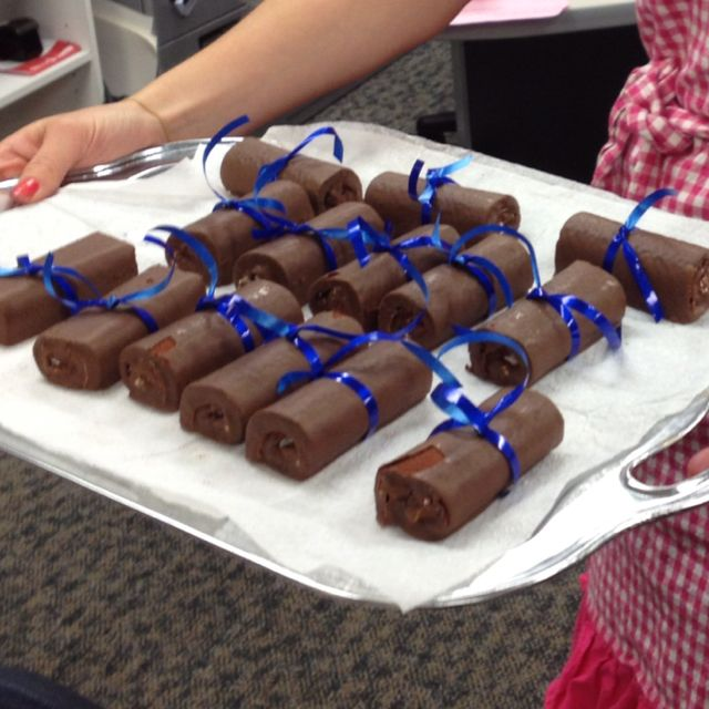 Hostess cakes wrapped with ribbons to look like scroll diplomas for graduation. Image only.