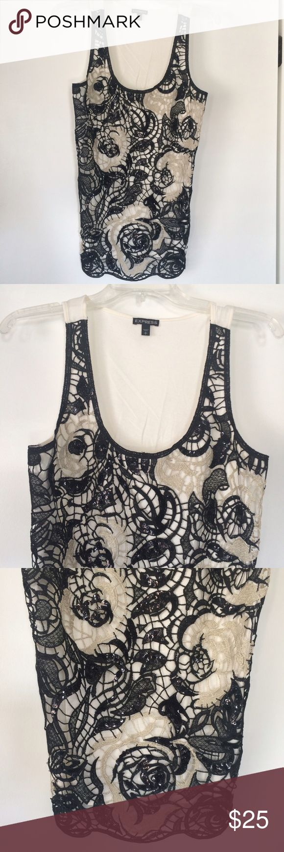 Express Floral Crochet Sequin Tank This tank is so pretty! Only worn a few times so still in excellent condition. The knit/sequin detail is stunning and the white/black rose theme lends a classic, Chanel-sequel touch. You will love it! Sz Small but could fit a S/M. Listing both sizes because it runs in between but the only shirt for sale is listed as a Small. Express Tops Tank Tops