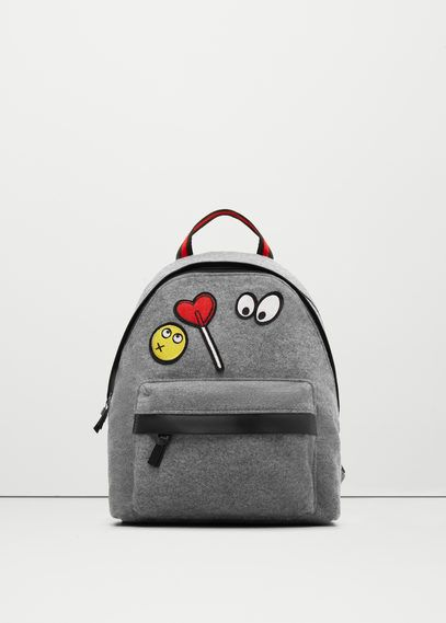 Backpack with decorative patches.