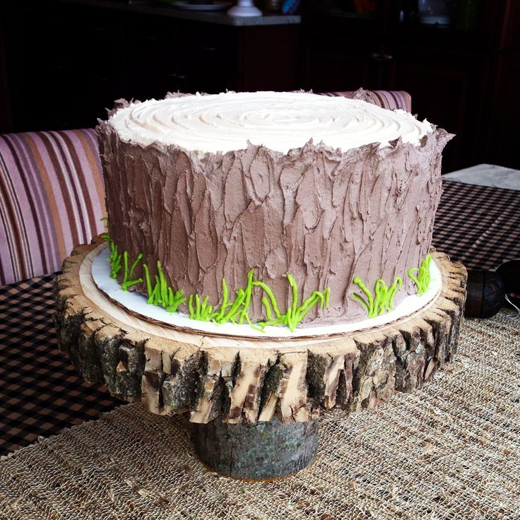 "I would have several layers of ""wood"" cake and deer antlers. Awesome!!!"