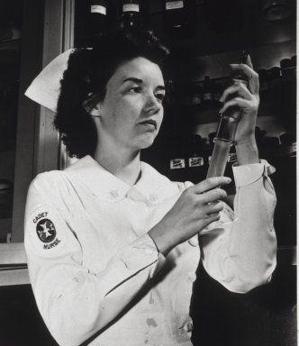 Images from the History of Medicine (NLM): A Cadet Nurse in hospital uniform fills a syringe