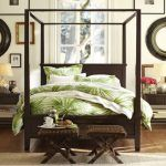 Tropical Bedroom Theme With Dark Brown Wooden Bed Frame And Coconut Tree Bedding Pattern
