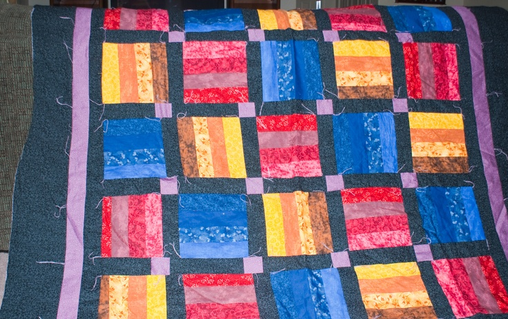 Different primary fabrics make up this quilt.