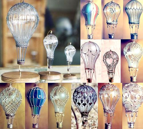 """Flying bulbs Deconstructed and embellished with wire decorations – Baroque style, some simple light bulbs become artistic sculptures. The intricate embellishments that encircle the bulbs transform them in expensive """"jewelries"""". Wonderful creations by Michael Wiegand."""