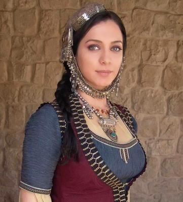 the Syrian actress Sulfa Fouakhrge, in a Syrian traditional dress.