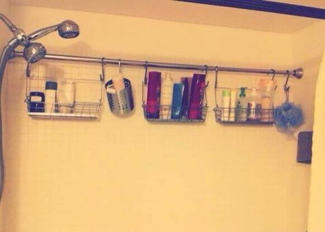 Add extra storage with an extra shower curtain rod, then all you have to so is hang up some shower caddies.