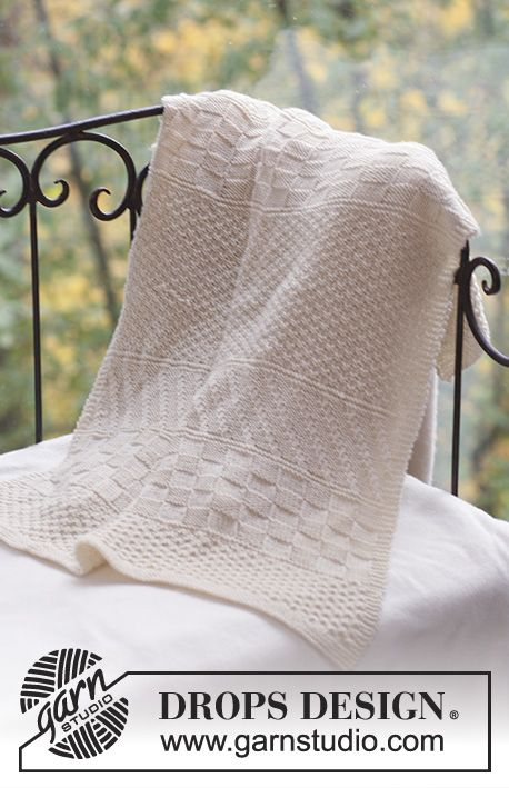 DROPS blanket with structured pattern in Merino Extra Fine. Free pattern by DROPS Design.