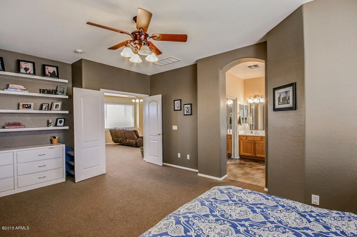 Traditional Master Bedroom with Built-in bookshelf, High ceiling, flush light, Carpet, Ceiling fan