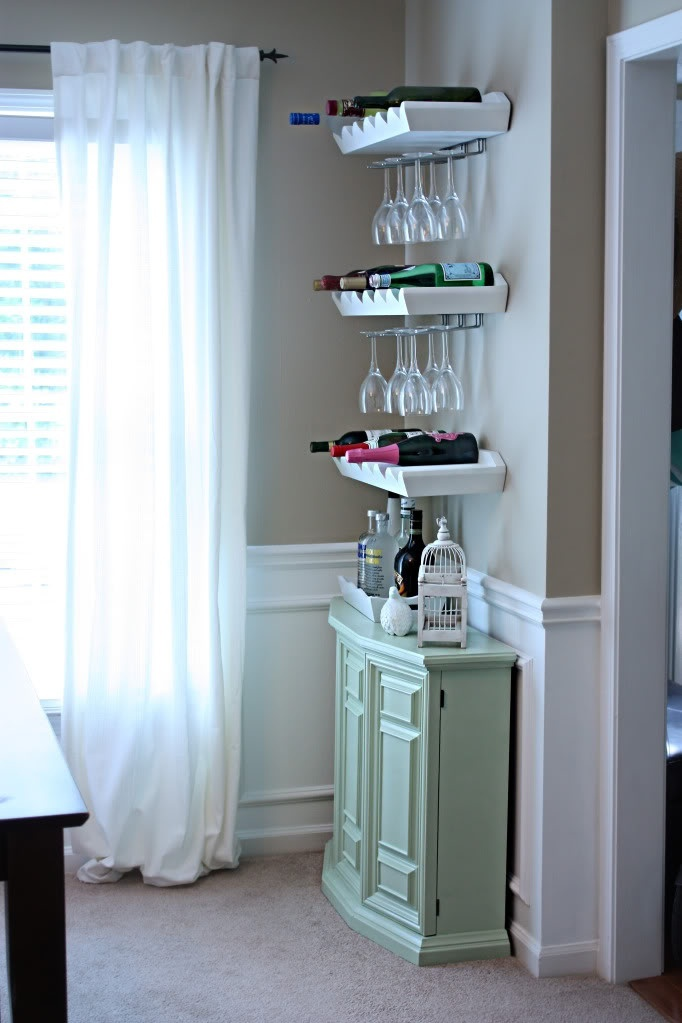 Charming idea for the dining room---a wine station / bar with storage cabinet and shelves that double as wine storage and glass racks.