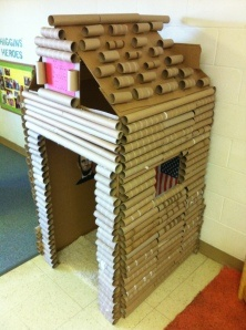 How to make a super cute log cabin/play house out of cardboard and empty gift wrap & paper towel  tubes.