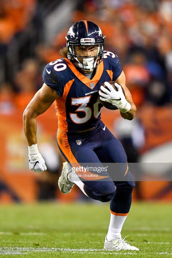 bd2f18ab Running back Phillip Lindsay of the Denver Broncos carries the ball ...