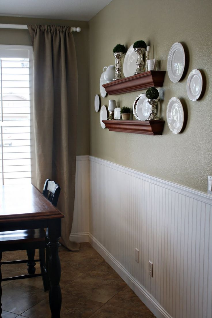 Paint a neutral color above white beadboard wainscoting in the kitchen that  wraps around through the