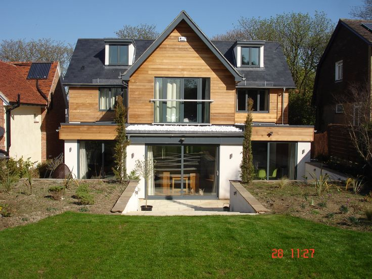 Rear view of Oxford house Trinity Properties. PTGV planed 135mm cover western red cedar. #cedarcladding