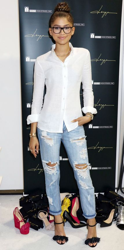 Zendaya in distressed boyfriend jeans that she elevated with a crisp white button-down shirt.