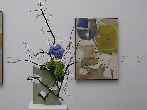 Interpretation of a Richard Diebenkorn painting.  Container was made to mimic the shape in the lower left corner.  Elm, Japanese Maple, Hydrangea.