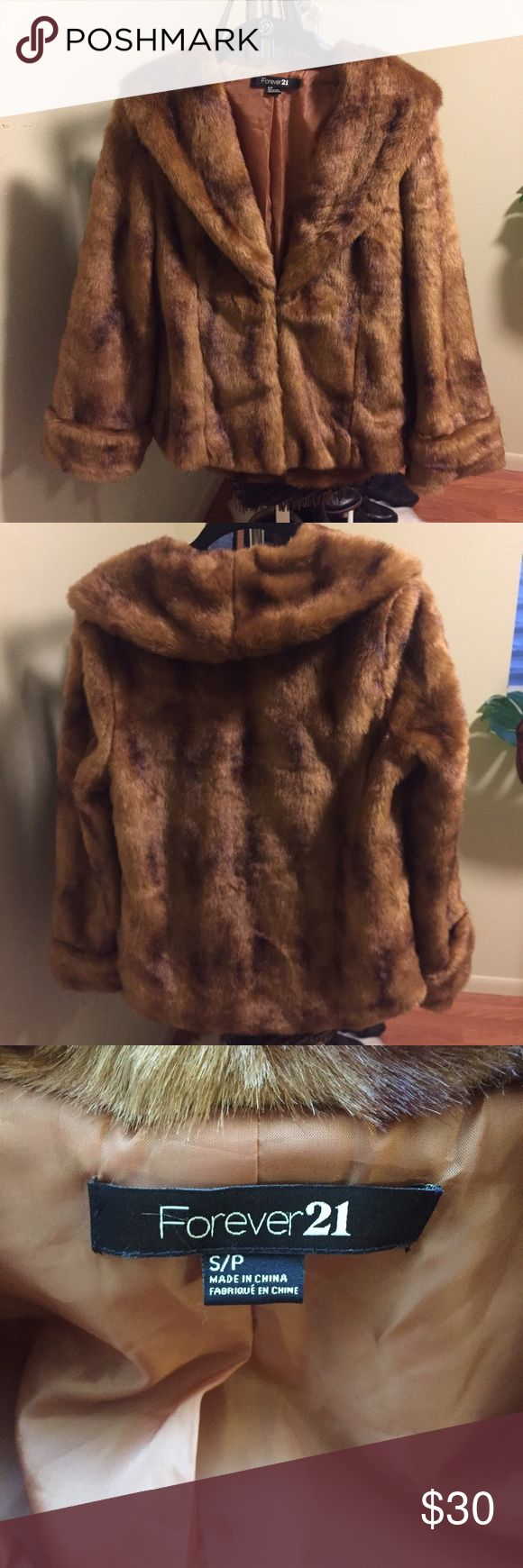 Faux Fur Coat, Forever 21 A gorgeous brown faux fur coat with a mock neck, satin lining, long sleeves, a single front hook and a boxy silhouette. I wore this coat one time so it's practically new! No trades. Forever 21 Jackets & Coats