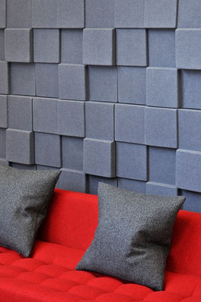 Acoustic wall panels give texture and a more unusual finish to this office design.