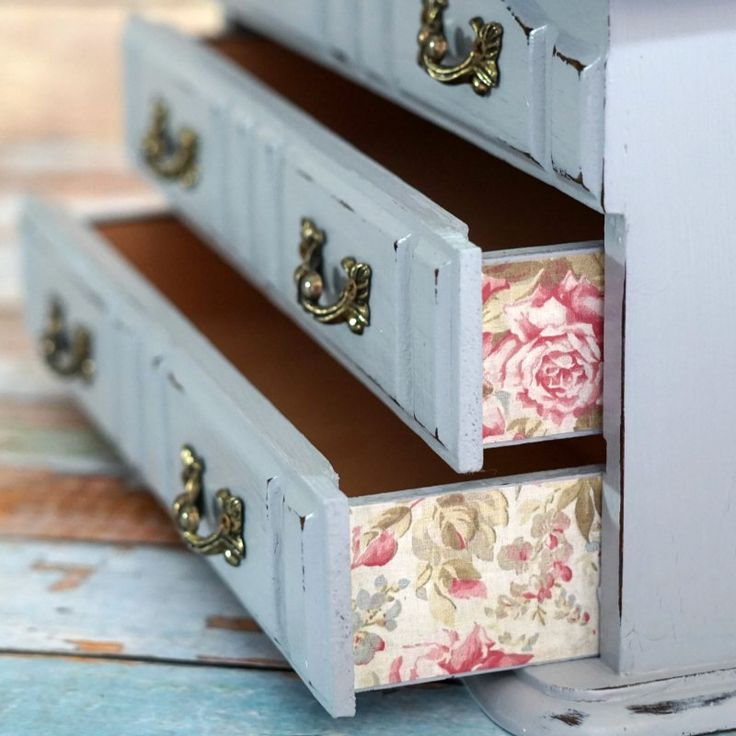 You've probably seen lots of these dark, dull old jewelry boxes at thrift stores. It's easy to turn one into a beautiful blue & pink jewelry box like this!