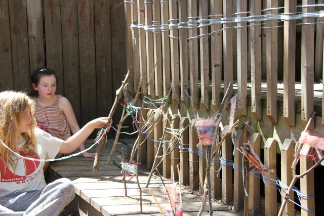 Sticks gathered from ravine, weaving yarn