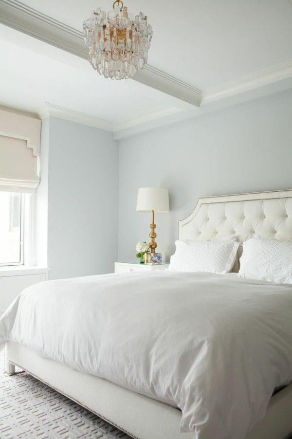 gorgeous white and blue bedroom features walls painted blue gray lined with a